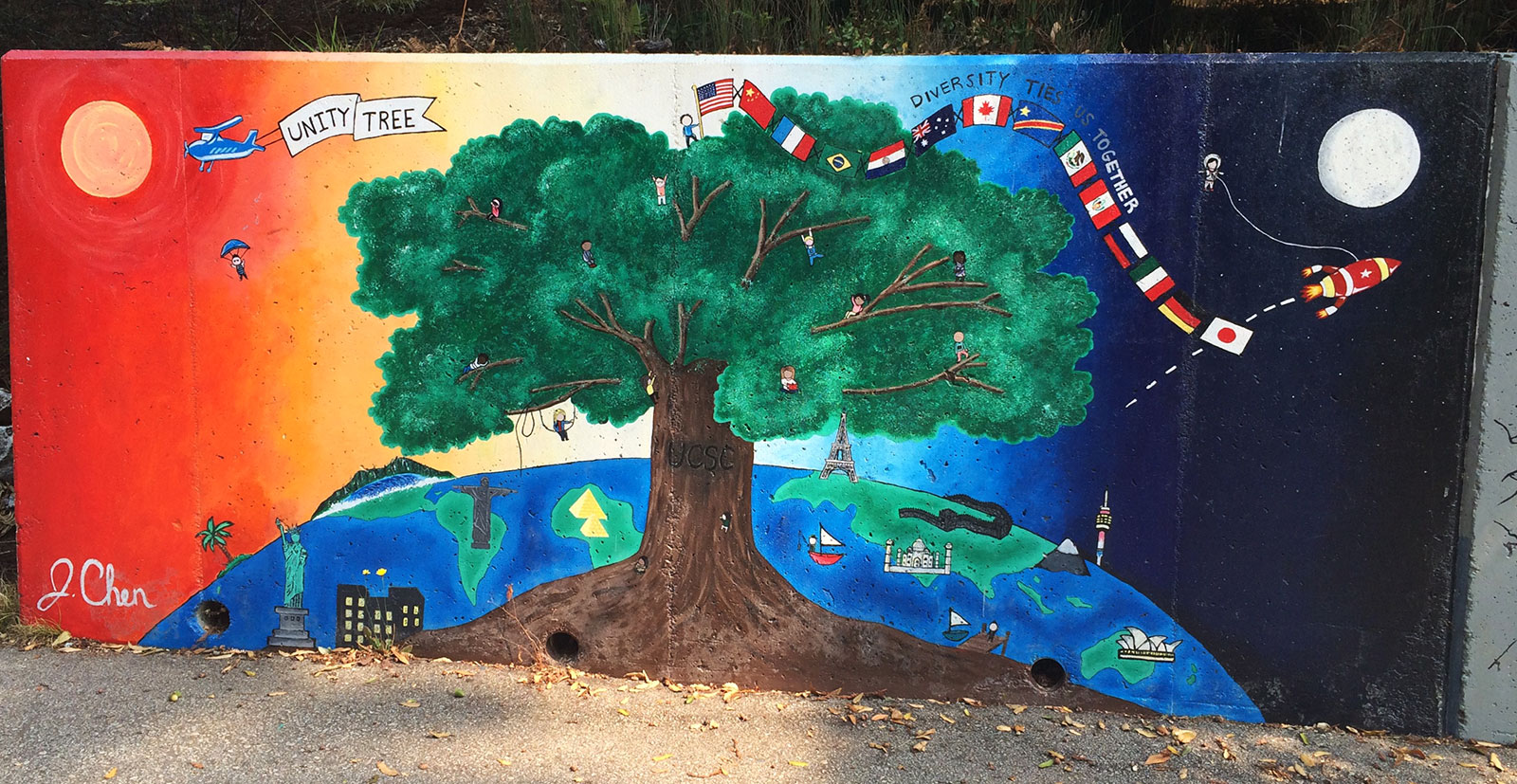 Mural with planet earth behind a big tree and multiple flags