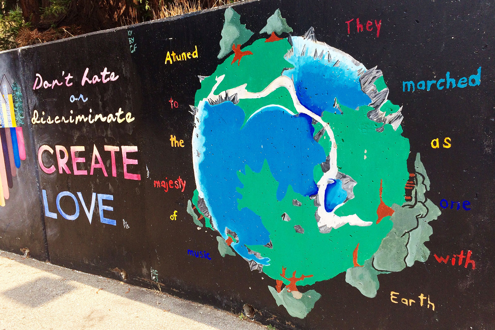 Mural with planet earth and different love messages