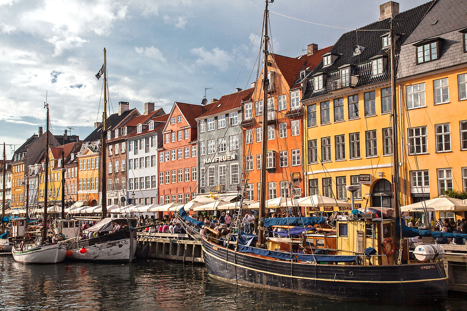 Boats and typical architecture buildings in Nyhavn, Copenhagen.