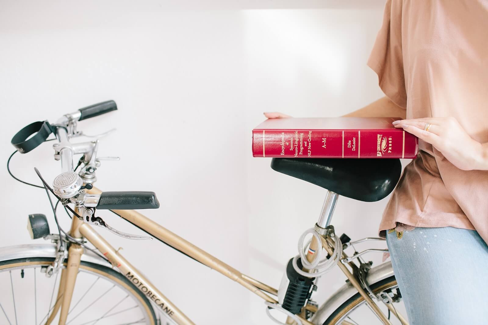 NLP book over bicycle seat as a simple life with presence