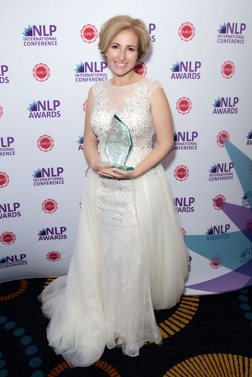 Rita Aleluia winning education category at NLP Awards 2019.